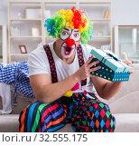 Купить «Drunk clown celebrating having a party at home», фото № 32555175, снято 12 мая 2017 г. (c) Elnur / Фотобанк Лори
