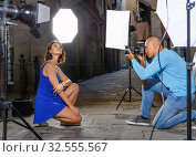 Professional photo shooting outdoors. Attractive female model posing to photographer on city street. Стоковое фото, фотограф Яков Филимонов / Фотобанк Лори