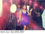 Купить «Young attractive woman delighted with professional photo shootin», фото № 32555587, снято 5 октября 2018 г. (c) Яков Филимонов / Фотобанк Лори