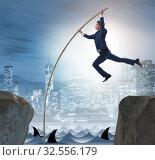 Купить «Businessman in pole vaulting concept», фото № 32556179, снято 11 декабря 2019 г. (c) Elnur / Фотобанк Лори