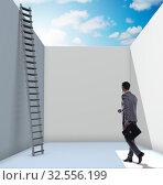 Купить «Businessman climbing a ladder to escape from problems», фото № 32556199, снято 11 декабря 2019 г. (c) Elnur / Фотобанк Лори