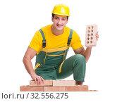 Купить «The handsome construction worker building brick wall», фото № 32556275, снято 5 ноября 2016 г. (c) Elnur / Фотобанк Лори