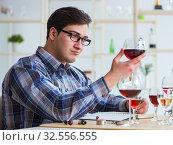 Купить «Professional sommelier tasting red wine», фото № 32556555, снято 31 марта 2017 г. (c) Elnur / Фотобанк Лори