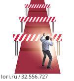 Купить «Businessman facing running barriers in challenging business», фото № 32556727, снято 9 декабря 2019 г. (c) Elnur / Фотобанк Лори
