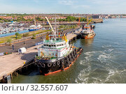 Купить «Newcastle, England - May 18, 2018: Harbor Newcastle along river Tyne with moored supply ship for offshore activities», фото № 32557607, снято 18 мая 2018 г. (c) age Fotostock / Фотобанк Лори