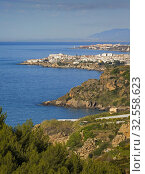 Nerja, Costa del Sol, Malaga Province, Andalusia, southern Spain. View from near Maro across fields to Nerja with the lighthouse of Torrox Costa visible behind. Стоковое фото, фотограф Ken Welsh / age Fotostock / Фотобанк Лори