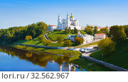 Купить «Holy Assumption Cathedral of Assumption on hill and Holy Spirit convent and Western Dvina River in summer. Vitebsk», фото № 32562967, снято 25 августа 2019 г. (c) Papoyan Irina / Фотобанк Лори