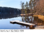 Купить «Morning at calm forest lake with frost on earth and wooden pier, cold autumn season. Sunlight from rising sun on the trees», фото № 32563199, снято 30 октября 2019 г. (c) Кекяляйнен Андрей / Фотобанк Лори
