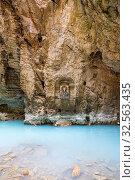 Купить «Сероводородное озеро и икона на стене в пещере Провал, Пятигорск», фото № 32563435, снято 22 февраля 2019 г. (c) Ольга Сейфутдинова / Фотобанк Лори