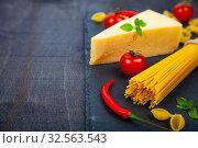 Купить «Spaghetti, cheese and chili peppers on a black background.», фото № 32563543, снято 13 апреля 2018 г. (c) Елена Блохина / Фотобанк Лори