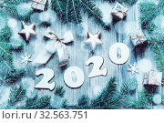 Купить «New Year 2020 background -2020 figures, Christmas toys, blue fir tree branches and snowflakes. New Year 2020 still life», фото № 32563751, снято 29 ноября 2016 г. (c) Зезелина Марина / Фотобанк Лори