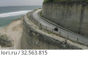 Купить «Bike on the road in Mountains Uluwatu Bali beach and rocks», видеоролик № 32563815, снято 29 октября 2019 г. (c) Aleksejs Bergmanis / Фотобанк Лори