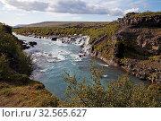 Купить «Die Wasserfaelle Hraunfossar mit dem blauen Fluss Hvitá, Westisland, Island, Europa», фото № 32565627, снято 1 июня 2020 г. (c) age Fotostock / Фотобанк Лори