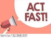 Handwriting text Act Fast. Concept meaning Voluntarily move in the highest state of speed initiatively Megaphone loudspeaker loud screaming scream idea talk talking speech bubble. Стоковое фото, фотограф Zoonar.com/Artur Szczybylo / easy Fotostock / Фотобанк Лори