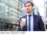 Купить «Portrait of cheerful male standing outdoor», фото № 32571147, снято 29 апреля 2017 г. (c) Яков Филимонов / Фотобанк Лори