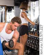 young athlete training biceps muscles. Стоковое фото, фотограф Яков Филимонов / Фотобанк Лори