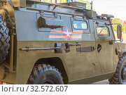 "Купить «Russia, Samara, May 2017: Army special armored car ""Tiger"" cooked for the parade on Victory Day on a spring sunny day.», фото № 32572607, снято 7 мая 2017 г. (c) Акиньшин Владимир / Фотобанк Лори"