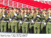 Купить «Russia, Samara, May 2016: The construction of soldiers with rifles for Victory Day at the rehearsal of the parade on Kuibyshev Square on a spring sunny day.», фото № 32572667, снято 7 мая 2017 г. (c) Акиньшин Владимир / Фотобанк Лори