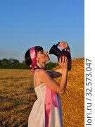 The girl on a mow drink a milk from jug. Стоковое фото, фотограф Арестов Андрей Павлович / Фотобанк Лори
