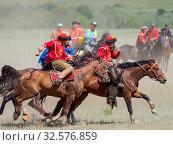 Купить «Kok Boru (Buzkashi), traditional equestrian team sport. Festival on the Suusamyr plain commemorating Mr Koshkomul, a sportsman and folk hero of the last...», фото № 32576859, снято 29 июня 2019 г. (c) age Fotostock / Фотобанк Лори
