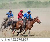 Купить «Kok Boru (Buzkashi), traditional equestrian team sport. Festival on the Suusamyr plain commemorating Mr Koshkomul, a sportsman and folk hero of the last...», фото № 32576959, снято 29 июня 2019 г. (c) age Fotostock / Фотобанк Лори