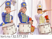 Russia, Samara, June 2017: beautiful girls in a hussar uniform play drums at a carnival procession at a flower festival in a city park on a summer day. Редакционное фото, фотограф Акиньшин Владимир / Фотобанк Лори