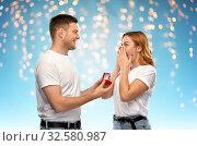 Купить «man giving woman engagement ring on valentines day», фото № 32580987, снято 6 октября 2019 г. (c) Syda Productions / Фотобанк Лори