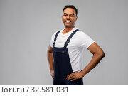 Купить «happy smiling indian worker or builder», фото № 32581031, снято 17 ноября 2019 г. (c) Syda Productions / Фотобанк Лори
