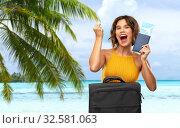 Купить «happy woman with ticket and travel bag on beach», фото № 32581063, снято 30 сентября 2019 г. (c) Syda Productions / Фотобанк Лори