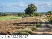 Rural road near Ornowo village in Ostroda County of Poland. Стоковое фото, фотограф Konrad Zelazowski / easy Fotostock / Фотобанк Лори