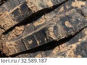 Купить «Close-up of old used rubber mud terrain tire with worn wear-resistant tread», фото № 32589187, снято 12 сентября 2019 г. (c) А. А. Пирагис / Фотобанк Лори