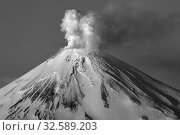 Купить «Winter active volcano of Kamchatka Peninsula, volcanic activity of Avacha Volcano: steam, gas ash erupting from crater. Dramatic black and white image», фото № 32589203, снято 25 февраля 2014 г. (c) А. А. Пирагис / Фотобанк Лори