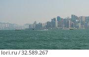 Купить «View from Star ferry at Victoria Harbor of Hong Kong», видеоролик № 32589267, снято 8 ноября 2019 г. (c) Игорь Жоров / Фотобанк Лори