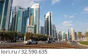 Купить «Doha, Qatar - Nov 18. 2019. Doha's Al Dafna area with the high-rises buildings», видеоролик № 32590635, снято 9 декабря 2019 г. (c) Володина Ольга / Фотобанк Лори
