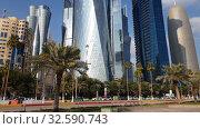 Купить «Doha, Qatar - Nov 18. 2019. Doha's Al Dafna area with the skyscrapers», видеоролик № 32590743, снято 9 декабря 2019 г. (c) Володина Ольга / Фотобанк Лори
