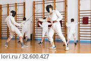 Купить «Smiling group practicing fencing techniques», фото № 32600427, снято 30 мая 2018 г. (c) Яков Филимонов / Фотобанк Лори
