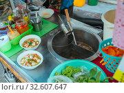 Купить «Street kitchen Pork soup with with noodles and herbs in Asia», фото № 32607647, снято 3 декабря 2018 г. (c) Aleksejs Bergmanis / Фотобанк Лори