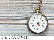 Купить «Retro pocket watch on gray wooden background», фото № 32610611, снято 20 января 2020 г. (c) easy Fotostock / Фотобанк Лори