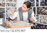 Купить «Woman choosing buttons in needlecraft store», фото № 32615967, снято 18 октября 2019 г. (c) Яков Филимонов / Фотобанк Лори