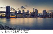 Купить «Brooklyn bridge East river and Manhattan at dusk», фото № 32616727, снято 4 декабря 2015 г. (c) Sergey Borisov / Фотобанк Лори