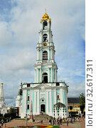 Sergiev Posad, Moscow region, Russia - August 15, 2019: Trinity-Sergiev Lavra, five-tier white stone bell tower with belfry. Редакционное фото, фотограф Сергей Трофименко / Фотобанк Лори