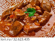 Купить «Anda Kaleji Tak-a-tak - Liver and egg cooked with a range of masalas, Pakistani cuisine», фото № 32623435, снято 26 февраля 2020 г. (c) easy Fotostock / Фотобанк Лори