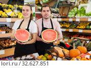 Купить «Glad woman and man holding half of watermelon», фото № 32627851, снято 27 апреля 2019 г. (c) Яков Филимонов / Фотобанк Лори