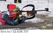 Sportswoman biathlete aiming, rifle shooting, reloading prone position. Kazakhstan biathlete Polina Yegorova in shooting range. Junior biathlon competitions East of Cup (2019 год). Редакционное видео, видеограф А. А. Пирагис / Фотобанк Лори