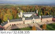 Купить «Fall view from drone of medieval Sychrov Castle, Czech Republic», видеоролик № 32638335, снято 18 октября 2019 г. (c) Яков Филимонов / Фотобанк Лори