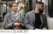 Купить «Positive bearded guy enjoying friendly conversation with young woman while traveling on subway train», видеоролик № 32638351, снято 11 ноября 2019 г. (c) Яков Филимонов / Фотобанк Лори