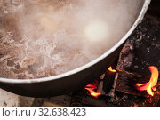 Купить «Beef broth with vegetables boiling in a cauldron», фото № 32638423, снято 23 сентября 2019 г. (c) EugeneSergeev / Фотобанк Лори