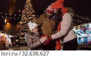 Купить «happy family with gift at christmas market in city», видеоролик № 32638627, снято 8 декабря 2019 г. (c) Syda Productions / Фотобанк Лори