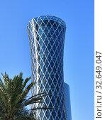 Купить «Doha, Qatar - Nov 24. 2019. Tornado Tower on sky background», фото № 32649047, снято 24 ноября 2019 г. (c) Володина Ольга / Фотобанк Лори