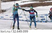 Купить «Kazakhstan team sportsman biathletes Kireyev Vladislav and Yegorova Polina skiing snow ski track relay race during Junior biathlon competitions East of Cup», видеоролик № 32649099, снято 14 апреля 2019 г. (c) А. А. Пирагис / Фотобанк Лори